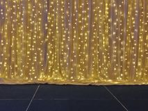 Yellow drape with many light bulb on stage. Gold drape with many yellow light bulb on stage Royalty Free Stock Images