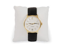 Gold dress watch with a pillow Stock Photography