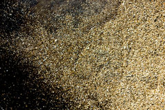 Gold dust on black background. Christmas decoration. Royalty Free Stock Photos