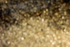 Gold dust decoration blured on black background Stock Images