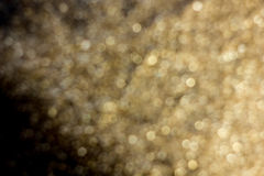 Gold dust decoration blured on black background Stock Photos