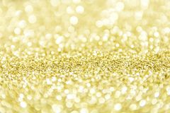 Gold dust fallen at the ground blur bokeh royalty free stock photos