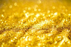 Gold dust powder sparkling glitter. Abstract background texture Royalty Free Stock Photo