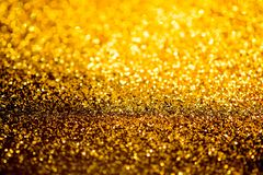 Gold dust sparkling glitter is worth. Abstract background Stock Photos