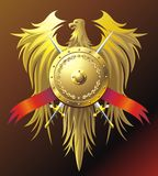 Gold eagle. Heraldic composition with eagle, buckler and sword Stock Photography
