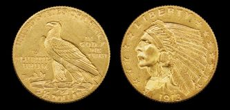 Gold Eagle Coin. Gold eagle two and a half dollar 1913 US coin with indian head isolated on black background stock photography