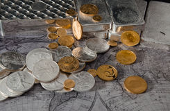 Gold Eagle & Silver Eagle Coins with Silver Bars on Map.  stock image