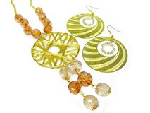 Gold earring and beads Stock Photos