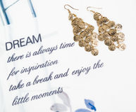 Gold earring with writing Royalty Free Stock Photos