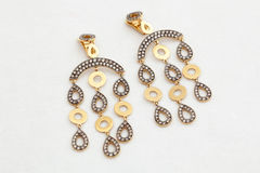 Gold earrings Royalty Free Stock Image