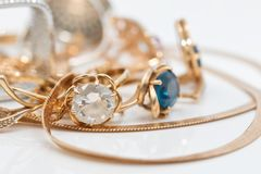 Free Gold Earrings And Rings From Different Sets Royalty Free Stock Photos - 119078468