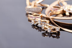 Gold earrings of different shapes Stock Image