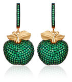 Gold earrings with green gems Stock Images