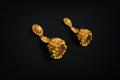 Gold Earrings Royalty Free Stock Images