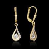 Gold earrings Stock Photos