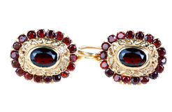 Gold earrings with ruby  Stock Photography