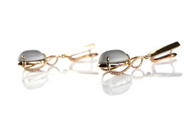 Gold earrings with smoky quartz Royalty Free Stock Photo