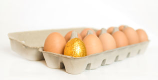 Gold easter egg in carton Royalty Free Stock Photos