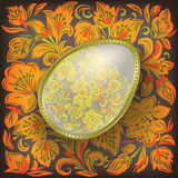 Gold easter egg on dark floral ornament Royalty Free Stock Image