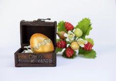 Gold Easter egg design in vintage wooden box stock photos