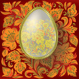 Gold easter egg on floral  background Stock Photography