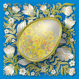 Gold easter egg on floral ornament Royalty Free Stock Photo