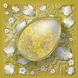 Gold easter egg on floral ornament Stock Photo