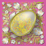 Gold easter egg on floral ornament Stock Photography