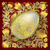 Gold easter egg on floral ornament Royalty Free Stock Photos