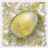 Gold easter egg on floral ornament Royalty Free Stock Photography