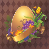 Gold Easter egg with flowers and gold ribbon tag Royalty Free Stock Image