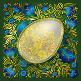 Gold easter egg on green floral ornament Stock Photo