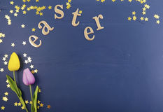 Gold Easter Letters on Wood Background. Stock Photos