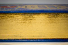 Gold edge of closed old vintage book with blue cover Stock Image