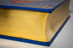 Gold edge of closed old vintage book with blue cover Stock Photos