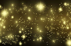 Gold effect pixie dust on black. Beautiful gold glittering stars and star dust. Bokeh golden sand, shining sparkles and lights. Horizontal festive glitter Royalty Free Stock Photography