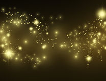 Gold effect pixie dust on black. Beautiful gold glittering stars and star dust. Bokeh golden sand, shining sparkles and lights. Horizontal festive glitter Stock Photos