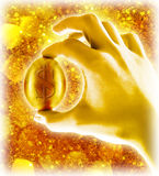 Gold egg. In hand on golden background stock photo