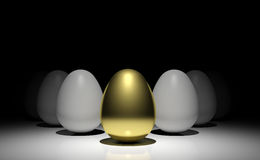 Gold egg. In front of white eggs on the stage Stock Image