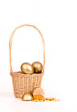 Gold egg in basket Stock Images