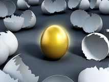 Gold egg at the center of cracked regular ones Stock Image