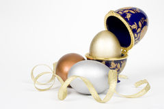 Gold egg in a eggcup Stock Photography
