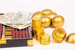 Gold egg,gold coin and dollar on white background Royalty Free Stock Photos