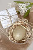 Gold egg in nest Stock Image