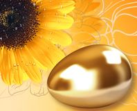 Gold egg and sunflower Royalty Free Stock Images