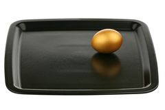 Gold egg on a tray Royalty Free Stock Photo