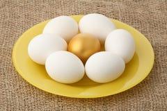 Gold egg among white Royalty Free Stock Photo