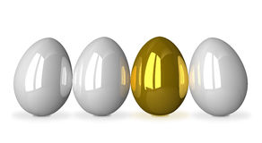 Gold egg among white ones Royalty Free Stock Photo