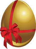 Gold Egg With Bow Stock Photography
