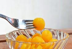 Gold egg yolk drop Thai sweet in fork Royalty Free Stock Photo